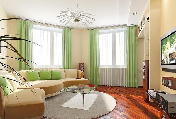 Выгодно обыграть угол гостиной можно диваном и другими предметами декора