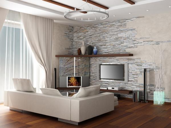 Хорошим решением станет отделка стен гостиной природными материалами