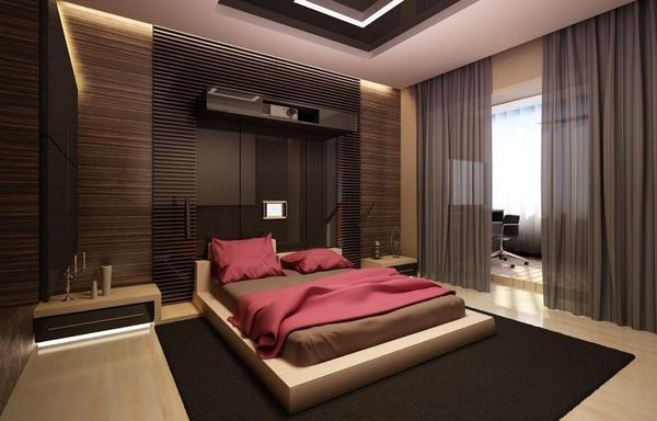 Атрибутами современной спальни являются неоновая подсветка возле тумбочек и встроенные в стену электронные гаджеты