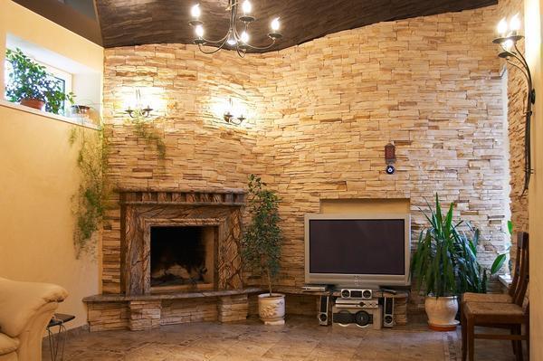 Декоративная плитка под натуральный камень хорошо сочетается с камином