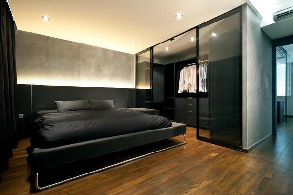 Для мужской спальни хорошо подойдут темные оттенки: черный, коричневый, серый
