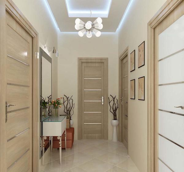 Для хорошего визуального восприятия прихожей лучше всего выбирать двери немного темнее, чем обои
