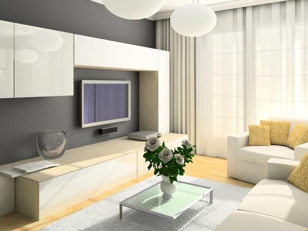 Для небольшой гостиной прекрасно подойдет красивая и компактная модульная стенка светлого цвета