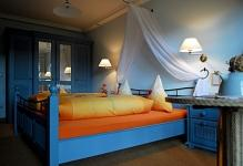 charm-blue-bedroom-yellow-linen-interior-design-ideas