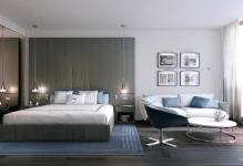 hotel-room-decor-with-picture-frame-and-white-sofa-and-white-round-table