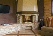 Описание и фото угловых каминов в интерьере гостиной: 5 разновидностей