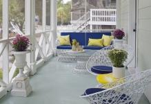 dewey-furniture-for-a-beach-style-porch-with-a-savannah-and-porch-by-rethink-design-studio