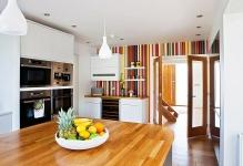 Creative-and-colorful-striped-accent-wall-for-a-crisp-modern-kitchen