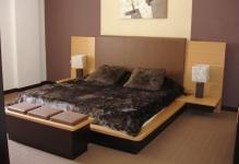 The-wonderful-redwood-bedroom-with-grey-blanket-and-wooden-bed-