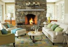 stone-fireplace-vacation-home-lodge-style-beach-colors-spa-living-room