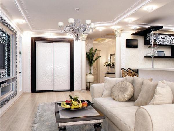 Шкаф в смежной гостиной-прихожей должен не только стильно дополнять интерьер помещения, но и быть функциональным и практичным