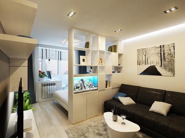 В небольшой спальне-гостиной диван лучше ставить вдоль стены, прямо перед телевизором и столиком
