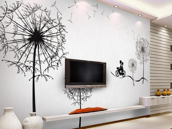 Пустую стену в гостиной дополнят наклейки, роспись или фотообои