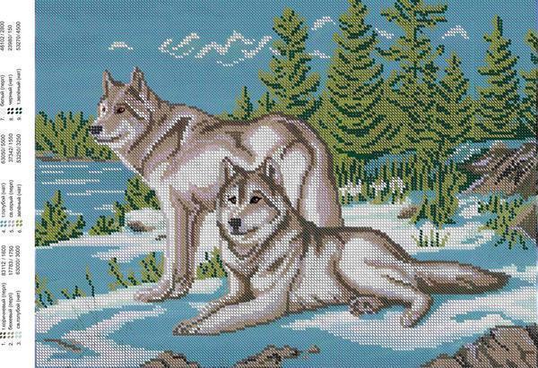 Вышивка, на которой изображены 2 волка на фоне леса, выглядит законченной