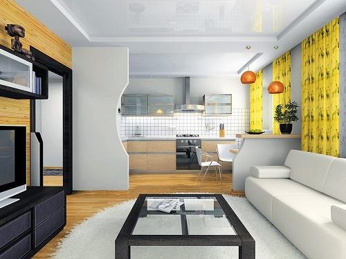 Совмещение кухни и гостиной выполняется с помощью архитектурных элементов, разделяющих помещение на функциональные зоны