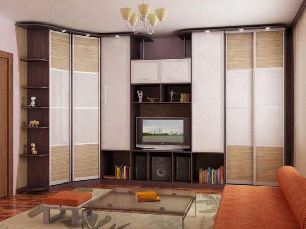 Угловой шкаф-купе вместе с другим мебельным гарнитуром способны стильно украсить интерьер помещения