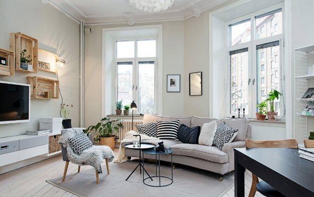 Сделать гостиную современной и стильной можно при помощи оформления комнаты в скандинавском стиле