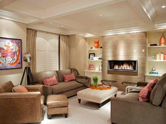 Наиболее популярным вариантом для современной гостиной является оформление комнаты в бежево-коричевых тонах