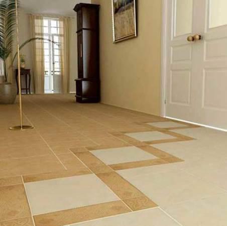 Сделать пол в коридоре более практичным можно при помощи красивой плитки