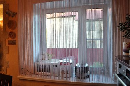 Нитяные шторы хорошо вписываются в любой интерьер вне зависимости от его стиля