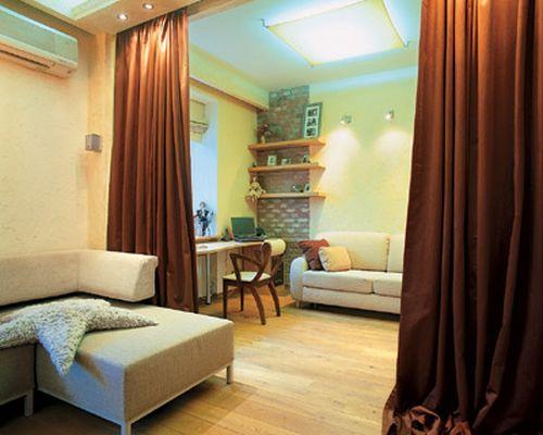 Быстро и легко произвести зонирование комнаты можно при помощи штор