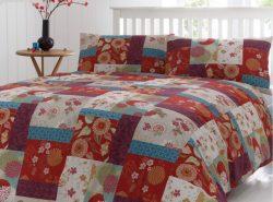 Одеяло в стиле пэчворк, выполненное своими руками, станет отличным украшением интерьера
