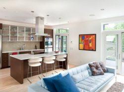 Гостиную и кухню можно успешно объединить в единое пространство, главное — придерживаться определенного стиля