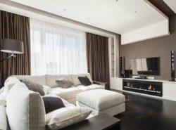 Сделать гостиную современной и функциональной поможет оформление комнаты в стиле хай-тек