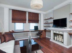 Декоративный камин из гипсокартона вполне может выступать главной изюминкой в интерьере гостиной