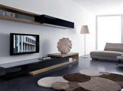 Современный стиль в оформлении гостиной позволит сделать ее максимально привлекательной в плане дизайна и вместе с тем достаточно функциональной