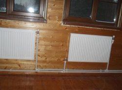 При выборе отопительной системы для загородного дома стоит учитывать материал, из которого он выполнен